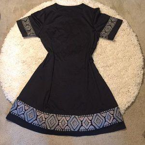 Black dress with metallic tribal design dress